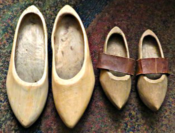 Adult- and children's-sized wooden shoes worn by Albert Bielefeld and his mother Ennegien