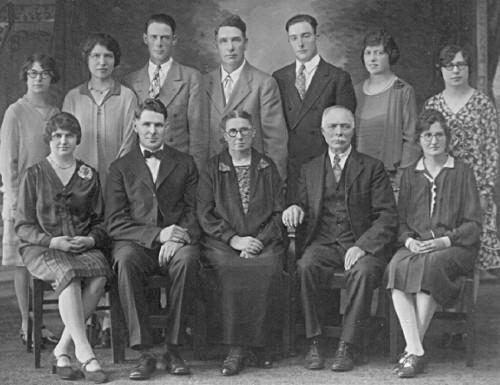 Black and white family photograph of Jan Hendrik Gemmen, Grace Broene Lotterman Gemmen, and their blended family.