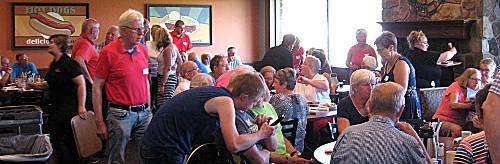Photograph of BIS members and tourist group from Grafschaft Bentheim at a group meeting in a restaurant