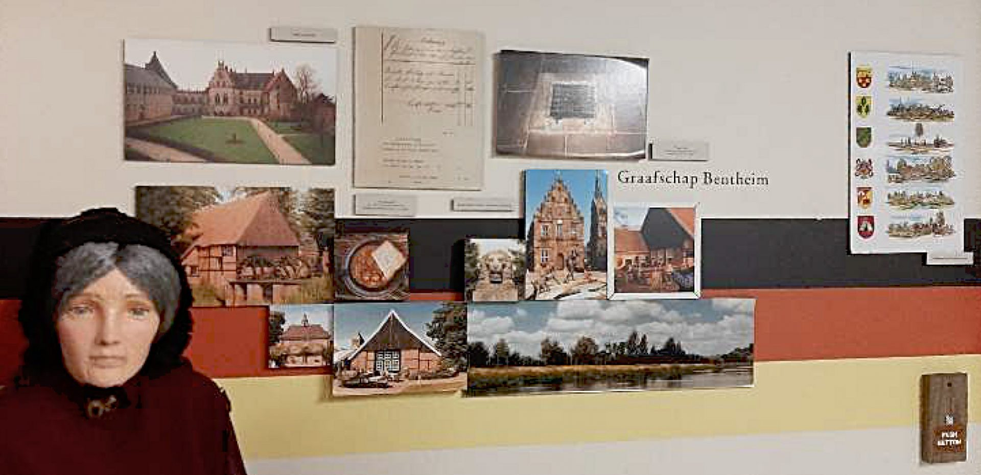 Photograph of museum exhibit of mannequin, photographs, and documents in a heritage museum that the tour group from Grafschaft Benthim visited