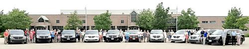 Photograph of the tourist group from Grafschaft Bentheim with their fleet of ten rented minivans