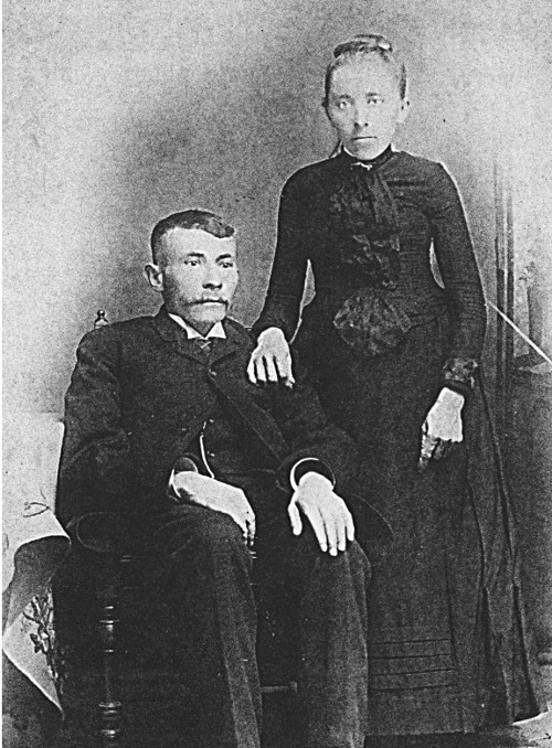 Photo of Albert Lotterman, sitting, and wife Susie, standing.