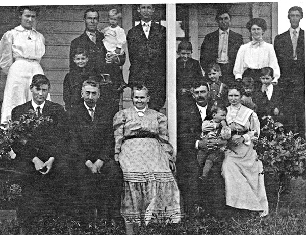 Large family posing on front porch