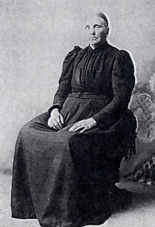 Hendrika Dyke sitting in a chair wearing a black dress