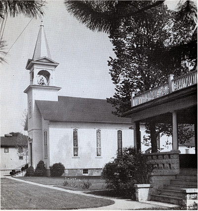 Photo of a wooden church with steeple