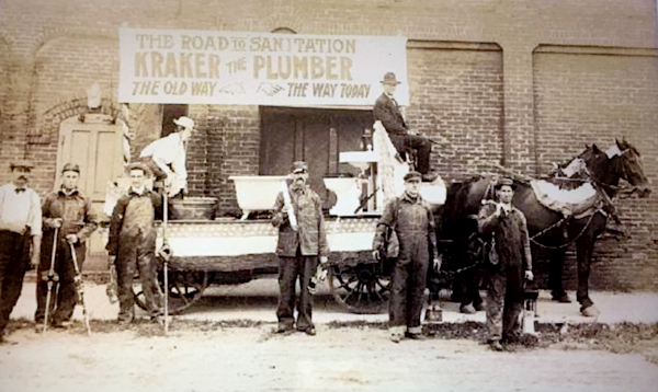 Photo of workers, horse-drawn wagon, and bathtub on wagon