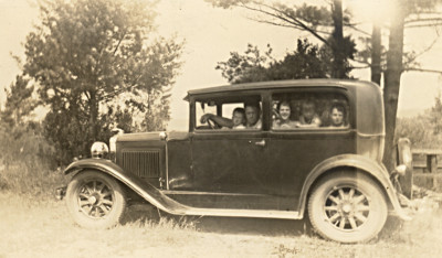 Photo of Ford Model A and passengers