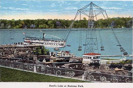Color postcard of Ramona Park at Reeds Lake showing an amusement ride and the lake.