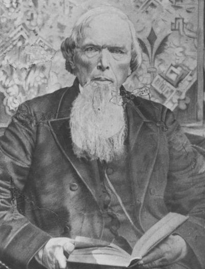 Portrait of man with Bible in lap