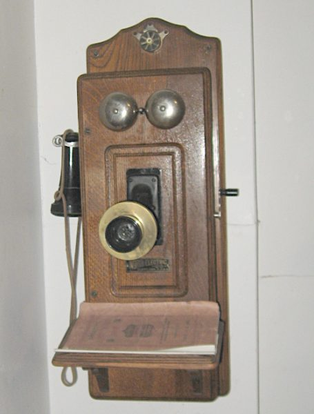 Photo of a hand-cranked wall telephone, like the one used by Julia Gemmen Kraker's family.