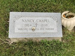 """Photo of a simple headstone reading, """"Nancy Chapel 1924 - 2018. Praising God still and forever."""""""