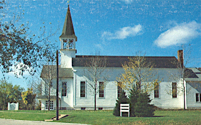 Side view of a white church with steeple. This church was built in 1862.