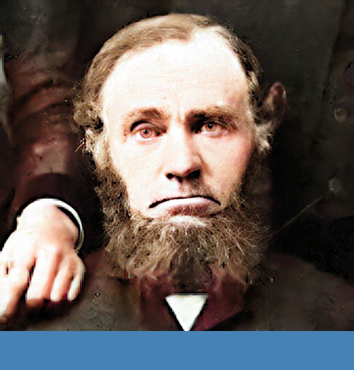 Colorized photo of Jan Harm Lemmen, early settler of Graafschap. He has brown hair and a beard.