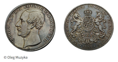 Photograph of a silver coin with a silhouette of King George V on one side and the Hanover coat of arms on the other.
