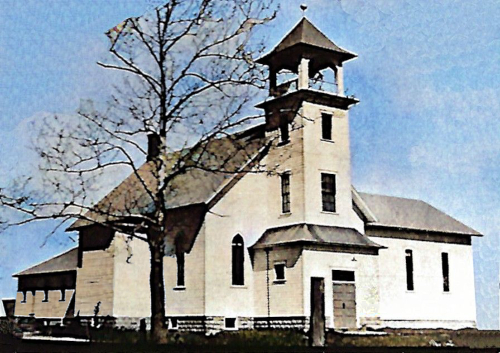 Photograph of the original Oakland Christian Reformed Church with steeple and bell. Harm Masselink helped to build this church